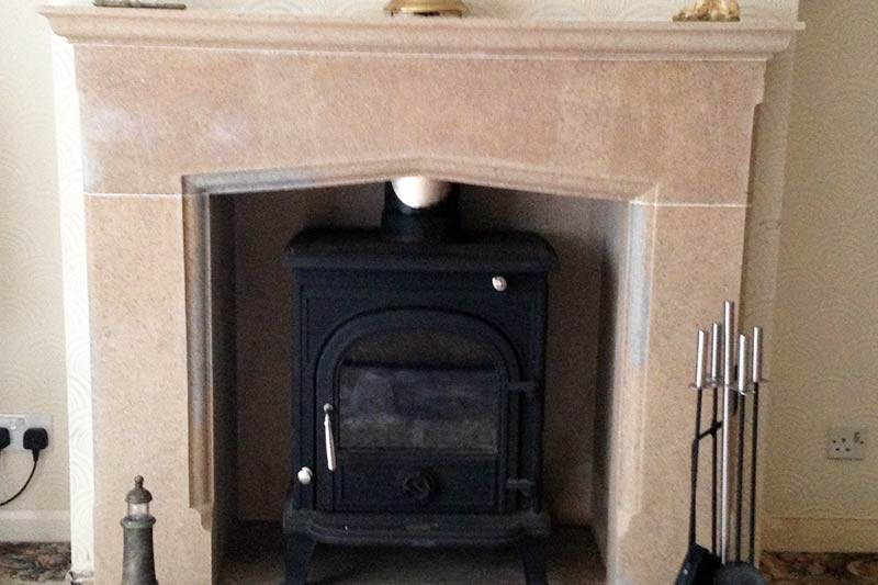 Large Limestone Fireplace fabricated by Ian Lowes Stonemasonry